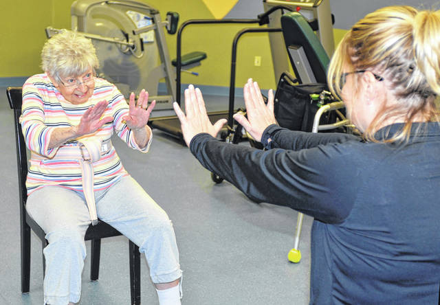 Mary Weaver, 85, left, was diagnosed with Parkinson's Disease over 15 years ago. She now works with Certified Occupational Therapy Assistant Kendra Boyer, right, to improve her speech and mobility through the LSVT BIG and LOUD program at Liberty Retirement Community of Lima. Craig Kelly | The Lima News