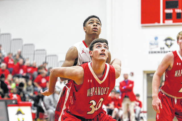 Wapakoneta's Ryan Carrico boxes out Perry's Chazz Jackson during Thursday night's game at Perry. See more game photos at LimaScores.com.