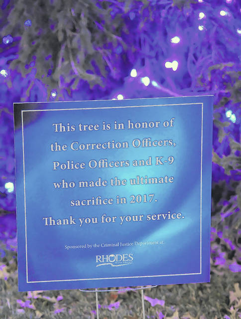 A tree at Rhodes States is in memory of fallen officers.