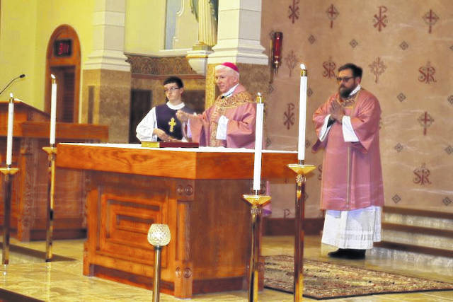 Bishop Daniel Thomas helped dedicate the newly remodeled St. Rose Catholic Church and school.