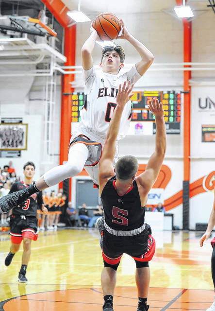 Elida's Matt Fish goes up for a shot against Shawnee's Johnny Caprella during Friday night's Mercy Health-St. Rita's Tip-Off Classic at Elida.