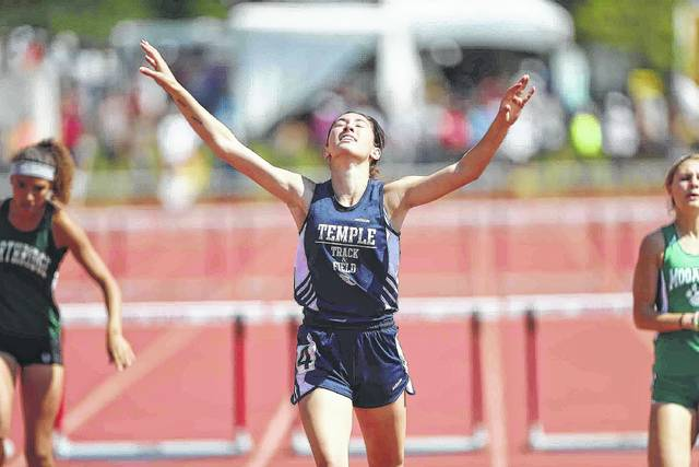 Temple Christian's Madison Yingst reacts to winning Division III girls 300-meter hurdles final during the state championships at Jesse Owens Memorial Stadium in Columbus.