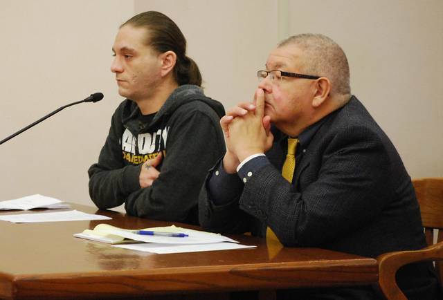 J Swygart | The Lima News Jonathon White of Lima, shown with attorney Joe Benavidez, pleaded guilty to reduced charges Monday for his role in the illegal dumping of scrap automobile tires in the south part of Lima.
