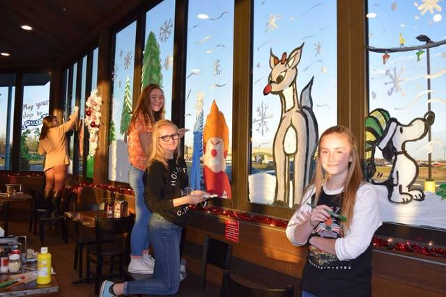 Elida High School students painted the windows of Mellow Mushroom recently. Submitted