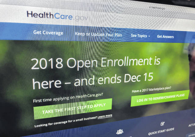The HealthCare.gov website is photographed in Washington on Dec. 15, 2017. A burst of sign-ups is punctuating the end of a tumultuous year for former President Barack Obama's health care law. Strong consumer interest around Friday's enrollment deadline for 2018 was seen as validation for the program's subsidized individual health insurance. But the Affordable Care Act's troubles aren't over. Even if full repeal now seems off the table, actions by the Republican-led Congress and the Trump administration could undermine the ACA's insurance markets.