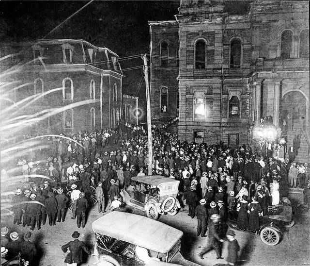 A mob gathers at the Allen County Courthouse in 1916, with the sheriff at the time credited with preventing violence.