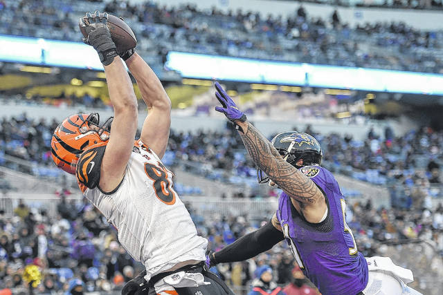 Cincinnati's Tyler Kroft (81) haulss in a touchdown pass against the Ravens' Kamalei Correa (51) during Sunday's game in Baltimore.