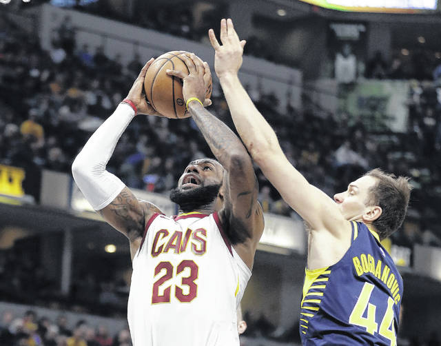 Cleveland's LeBron James puts up a shot against Indiana's Bojan Bogdanovic during Friday night's game in Indianapolis.