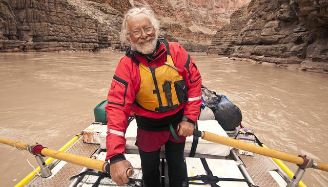 This 2010 photo provided by Northern Arizona University shows photographer John Running on the Colorado River. Running died Sunday, Jan. 7, 2018, of complications from a brain tumor at his Flagstaff home, said his daughter, Raechel Running. He was 77. (Northern Arizona University via AP)