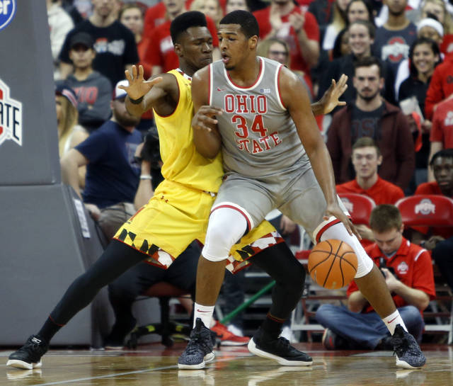 Ohio State's Kaleb Wesson, right, posts up against Maryland's Bruno Fernando during the first half of an NCAA college basketball game Thursday, Jan. 11, 2018, in Columbus, Ohio. (AP Photo/Jay LaPrete)