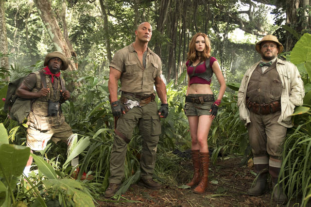 "FILE - This file image released by Sony Pictures shows Kevin Hart, from left, Dwayne Johnson, Karen Gillan and Jack Black in ""Jumanji: Welcome to the Jungle.""  (Frank Masi/Sony Pictures via AP, File)"