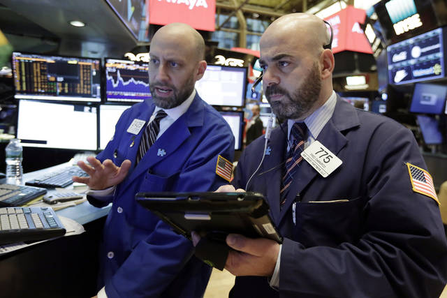 Specialist Meric Greenbaum, left, and trader Fred DeMarco work on the floor of the New York Stock Exchange, Wednesday, Jan. 17, 2018. Stocks are opening higher on Wall Street as the market makes up some of the ground it lost a day earlier. (AP Photo/Richard Drew)