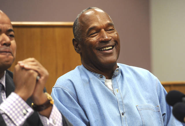 Former NFL football star O.J. Simpson laughs in July as he appears via video for his parole hearing at the Lovelock Correctional Center in Lovelock, Nev. Simpson enjoys living in Las Vegas and isn't planning to move to Florida like he told state parole officials before he was released in October from Nevada state prison.