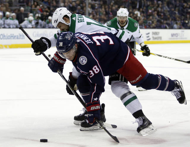 Columbus Blue Jackets forward Boone Jenner (38) works for the puck against Dallas Stars forward Jamie Benn during the first period of an NHL hockey game in Columbus, Ohio, Thursday, Jan. 18, 2018. (AP Photo/Paul Vernon)