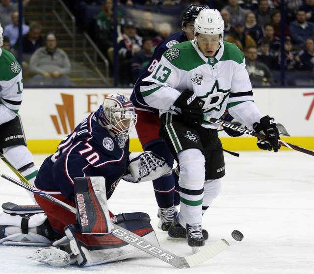 Columbus Blue Jackets goalies Joonas Korpisalo, left, of Finland, stops a shot against Dallas Stars forward Mattias Janmark, of Sweden, during the first period of an NHL hockey game in Columbus, Ohio, Thursday, Jan. 18, 2018. (AP Photo/Paul Vernon)
