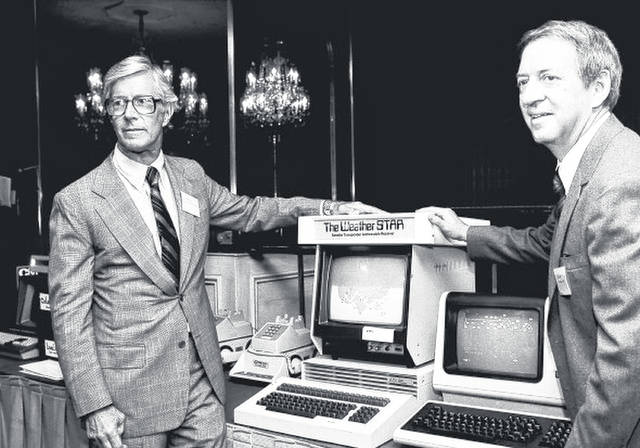 CORRECTS THAT COLEMAN IS AT RIGHT, NOT LEFT - In this July 30, 1981 photo,  John Coleman, weather channel founder, right, and Frank Batten, publisher of the Norfolk, Va., Virginian-Pilot and Ledger-Star, and chairman and chief executive of Landmark Communications, Inc., are seen during a news conference in New York. John Coleman, the founder of The Weather Channel and longtime KUSI weatherman, died Saturdaty night, Jan. 20, 2018, at home in Las Vegas, said his wife Linda Coleman. He was 83.  (AP Photo/Marty Lederhandler, File)