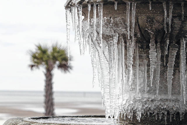 Icicles hang from the fountain at Beau View condominiums in Biloxi, Miss., on Monday, Jan. 1, 2018. A hard freeze hit South Mississippi overnight and temperatures are expected to remain near or below freezing for the rest of the week.