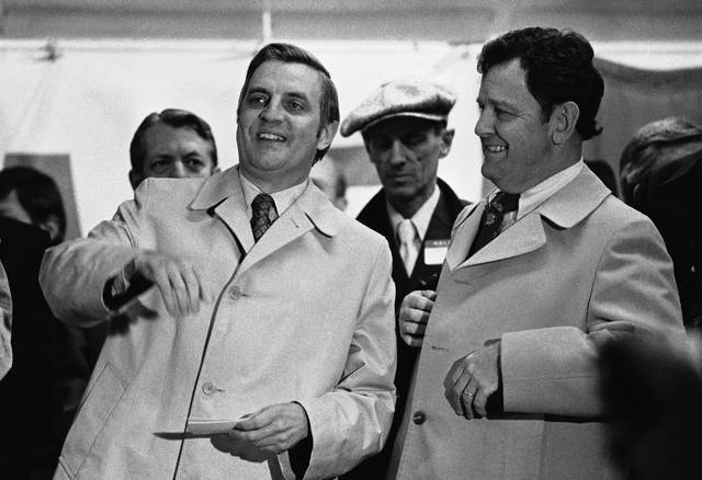 FILE - In this Dec. 2, 1977 file photo, U.S. Vice President Walter Mondale, left, points out a sign in the crowd to U.S. Rep. Tom Luken, D-Ohio, at dedication ceremonies for a new bus terminal area in downtown Cincinnati.   The former Ohio congressman and Cincinnati mayor who was a Democratic force in a decades-long political career and known for mentoring young politicians such as Jerry Springer has died.  Luken's son, Charlie Luken, told reporters that his father passed away Wednesday, Jan. 10, 2018. (AP Photo)