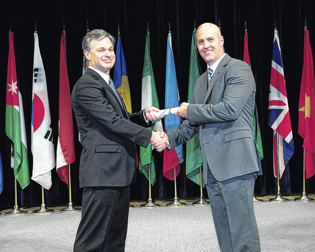 Lima Police Department Lt. Andy Green, right, graduated earlier this month from the FBI National Academy in Quantico, Virginia. He was presented his diploma by FBI Director Christopher Wray.