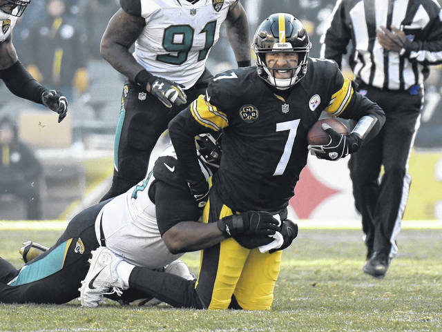 Pittsburgh Steelers quarterback Ben Roethlisberger (7) is brought down by Jacksonville Jaguars defensive tackle Marcell Dareus (99) during the first half of an NFL divisional football AFC playoff game in Pittsburgh on Sunday.