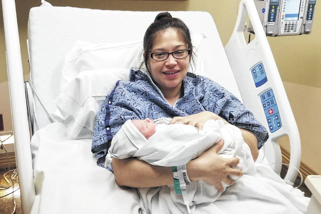 Cayla Moralez holds her son, Elijah Whitaker, who was born at 2:58 a.m. Jan. 1.