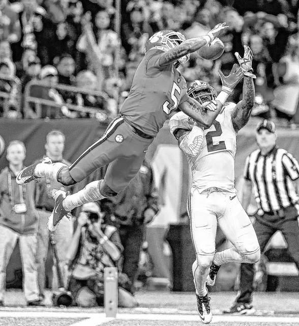 Clemson wide receiver Tee Higgins (5) leaps for a pass at the goal line as Clemson cornerback Mark Fields (2) breaks up the throw in the first half of the Sugar Bowl semi-final playoff game.