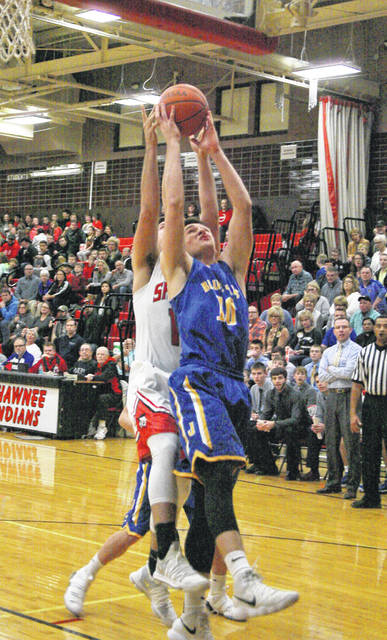 Jared Wurst of Delphos St. John's grabs a rebound during Saturday night's game at Shawnee.