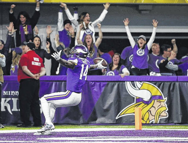 Minnesota Vikings wide receiver Stefon Riggs (14) celebrates in the end zone after a game winning touchdown against the New Orleans Saints in the final minute during the second half of an NFL divisional football playoff game in Minneapolis on Sunday.