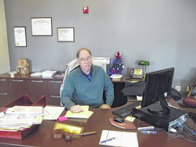 Auglaize County Municipal Court Judge Gary Herman sits behind his desk for a final time Friday, Dec. 29. After 36 years on the bench, Herman retired at the end of 2017.