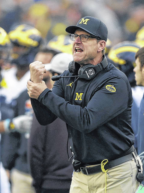 Michigan head coach Jim Harbaugh looks for a holding during the second half of the Outback Bowl on Monday on a day when the Wolverines couldn't hold on to the lead.