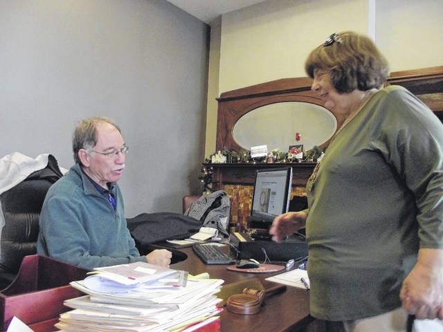 Auglaize County Municipal Court Judge and Sally Imondi, Auglaize County probation officer, talk Friday, Dec. 29, on Herman's last day in office.