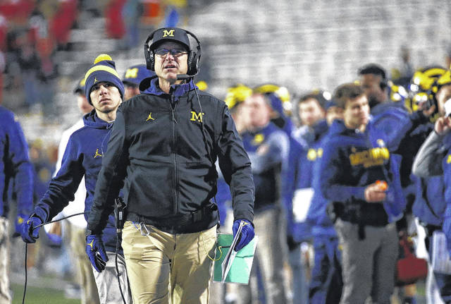 Michigan head coach Jim Harbaugh walks on the sideline during a game against Maryland in College Park, Md. earlier this season. Michigan has proved harder to turn around for Harbaugh than many people expected.