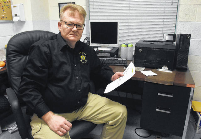 Darrell Craft in his office at the Allen County Sheriff's Office. Craft is a psychological services coordinator at the county jail.