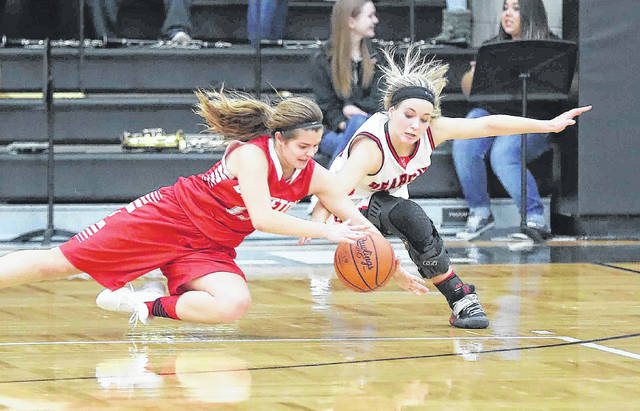 Bluffton's Averey Rumer and Spencerville's Jayden Smith go after a loose ball during Thursday night's game at Spencerville.