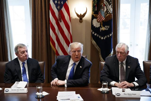In this Jan. 9, 2017, photo, Sen. Dick Durbin, D-Ill., left, and Rep. Steny Hoyer, D-Md. listen as President Donald Trump speaks during a meeting with lawmakers on immigration policy in the Cabinet Room of the White House in Washington. Bargainers seeking a bipartisan immigration accord planned talks as soon as Wednesday as President Donald Trump and leading lawmakers sought to parlay an extraordinary White House meeting into momentum for resolving a politically blistering issue.