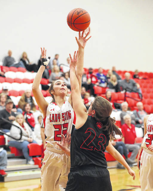 Wapakoneta's Katie Engel puts up a shot against Kenton's Caitlin Tudor during Thursday night's game in Wapakoneta. See more game photos at LimaScores.com.