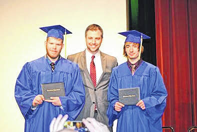 The Marsh Foundation Schol Principal, Robbie Breese, stands between winter graduates, Xavier Puterbaugh (left) and Zildgian Galliher (right).