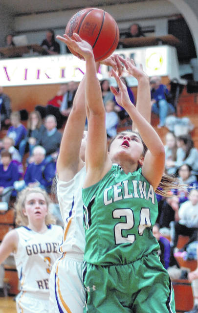 Celina's Emily Braun loses her shot Wednesday night to Bryan's Kennedy Lamberson during the first half at Leipsic High School in Leipsic.