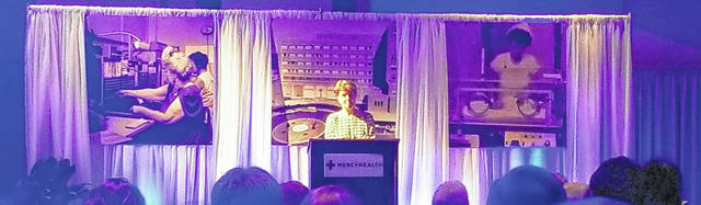 Dr. Anne Gideon, former chief of staff and board chairwoman, addresses the crowd Thursday night to celebrate Mercy Health-St. Rita's 100 years in business.