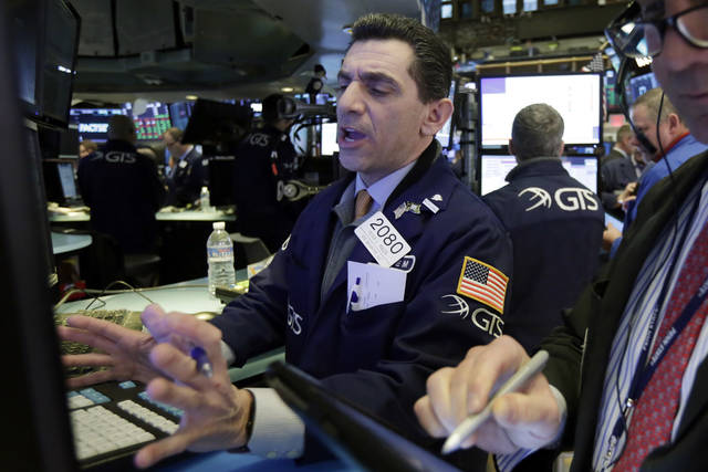 Specialist Peter Mazza works at his post on the floor of the New York Stock Exchange, Wednesday, Feb. 7, 2018. Stocks are opening modestly higher on Wall Street as the market stabilizes following three days of tumult. (AP Photo/Richard Drew)