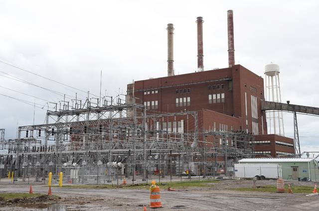 FILE - This April 7, 2016, file photo, shows the exterior of Consumers Energy's J.R. Whiting Generating Plant in Luna Pier, Mich. Consumers Energy will phase out electricity production from coal by 2040 to slash emissions of heat-trapping gases that cause global warming, the Michigan utility's president and CEO told The Associated Press. (Tom Hawley/The Monroe News via AP, File)