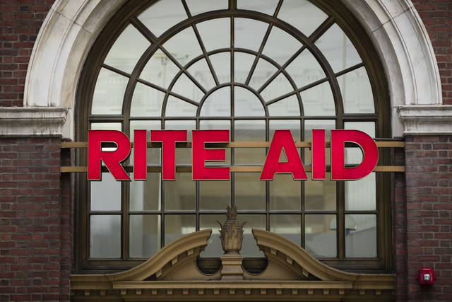 FILE - This Oct. 21, 2016 file photo shows a Rite Aid location in Philadelphia. The privately held owner of Safeway, Vons and other grocery brands is plunging deeper into the pharmacy business with a deal to buy Rite Aid, the nation's third-largest drugstore chain. Albertsons Companies is offering either a share of its stock and $1.83 in cash or slightly more than a share for every 10 shares of Rite Aid. A deal value was not disclosed in a statement released Tuesday, Feb. 20, 2018,  by the companies. (AP Photo/Matt Rourke)