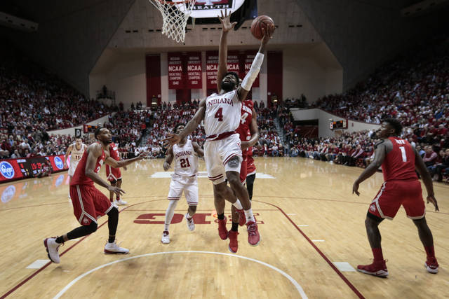 Indiana guard Robert Johnson (4) shoots in front of Ohio State forward Kaleb Wesson during the first half of an NCAA college basketball game in Bloomington, Ind., Friday, Feb. 23, 2018. (AP Photo/AJ Mast)