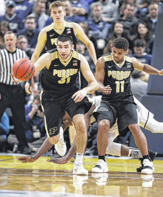 Purdue's Dakota Mathias (31) pushes the ball upcourt during an 82-67 win over Butler earlier this season. Mathias is one of four senior starters for the No. 3 Boilermakers.