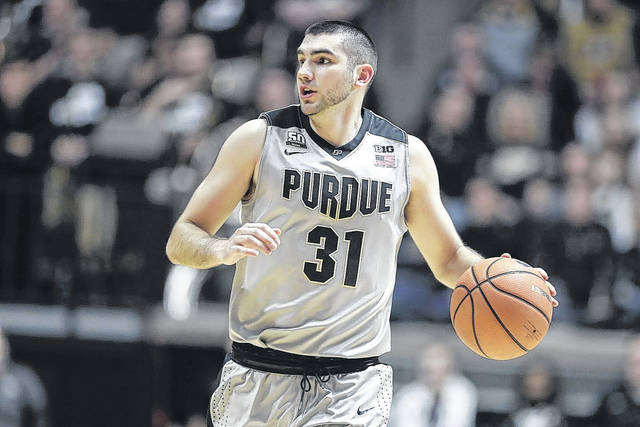 Purdue guard Dakota Mathias (31) brings the ball up court against Nebraska in the second half of an NCAA college basketball game in West Lafayette, Ind., Saturday, Jan. 6, 2018. Purdue defeated Nebraska 74-62. (AP Photo/Michael Conroy)
