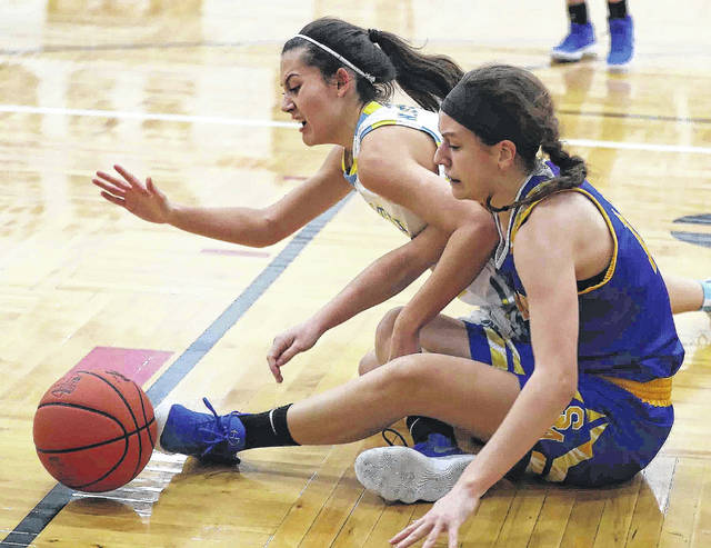 Bath's Jaidyn Hale, left, and St. Marys' Jill Schmitmeyer hit the floor to pursue a loose ball during a Division II sectional final Saturday at Spencerville.