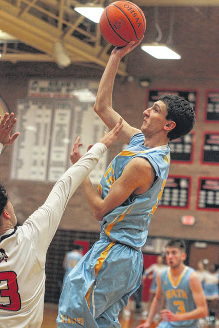 Bath's Chad Frey puts up a shot against Shawnee's Riley Rosado during Friday night's game at Shawnee.