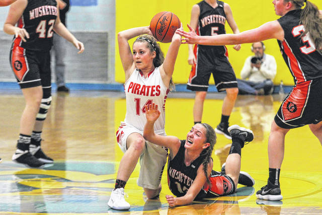 Bluffton's Laykin Garmatter comes up with the loose ball against Fort Jennings' Madison Neidert on Wednesday night during the Division IV Sectional Tournament at Bath.