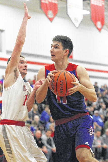 Crestview's Derek Stout drives against Columbus Grove's Grayson Flores during Friday night's game at Columbus Grove.