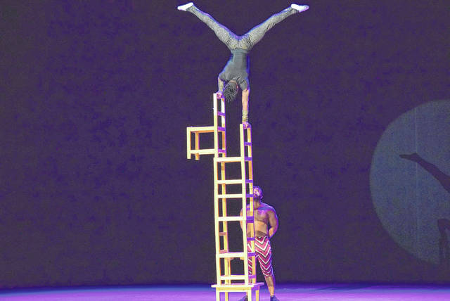An unnamed Cirque Zuma Zuma performer shows his balancing skills.
